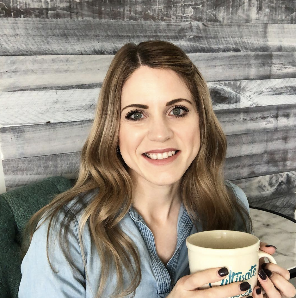 a photo of a woman with a coffee cup