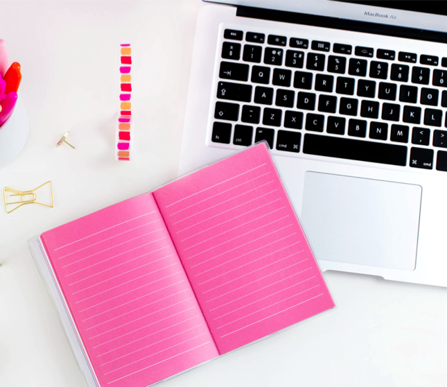 pink journal and laptop